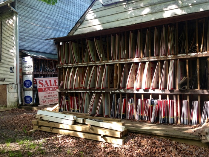 Then I found these for sale signs. So was this structure a real estate office at some point? Because I can't think of any other explanation why there would be hundreds of for-sale-signs stored here.