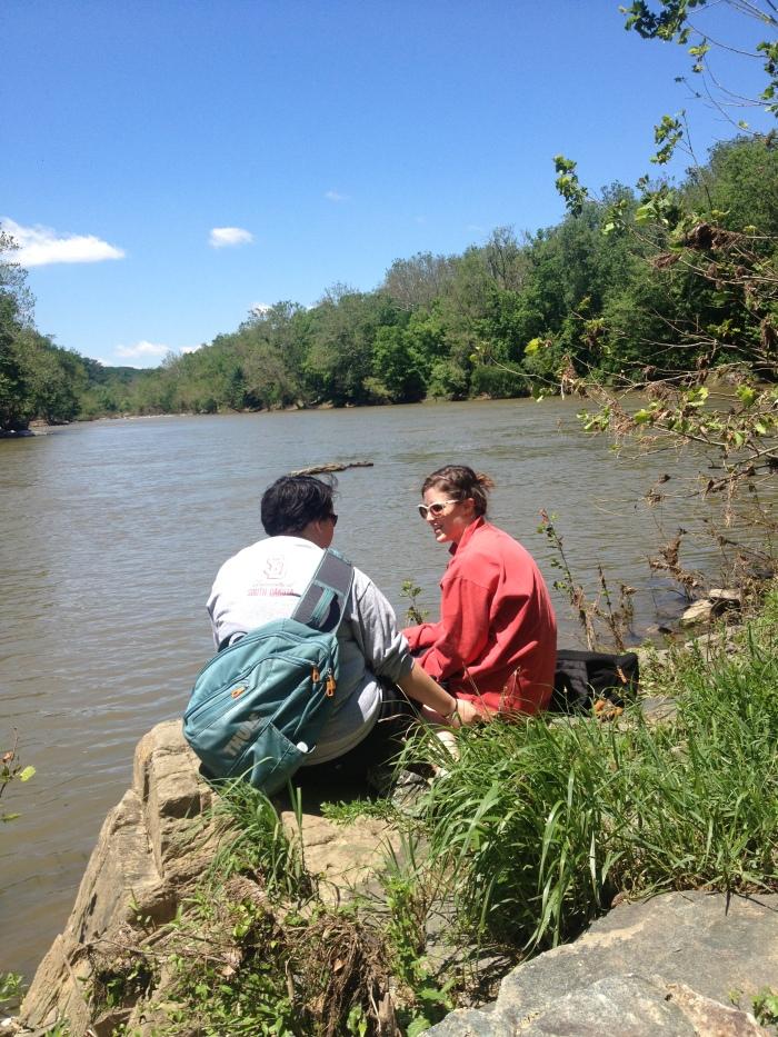 Kim and Nora having a deep conversation on the Potomac.