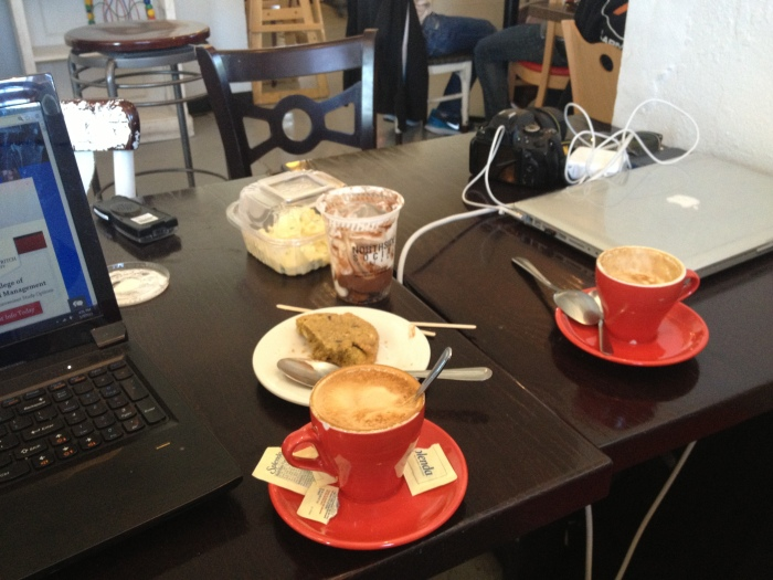 Cappuccinos, laptobs and cookies.