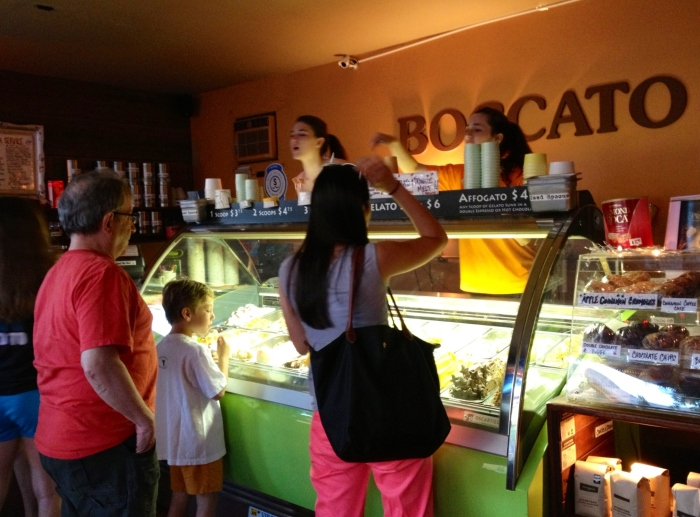 Picking out a flavor at the gelato counter.