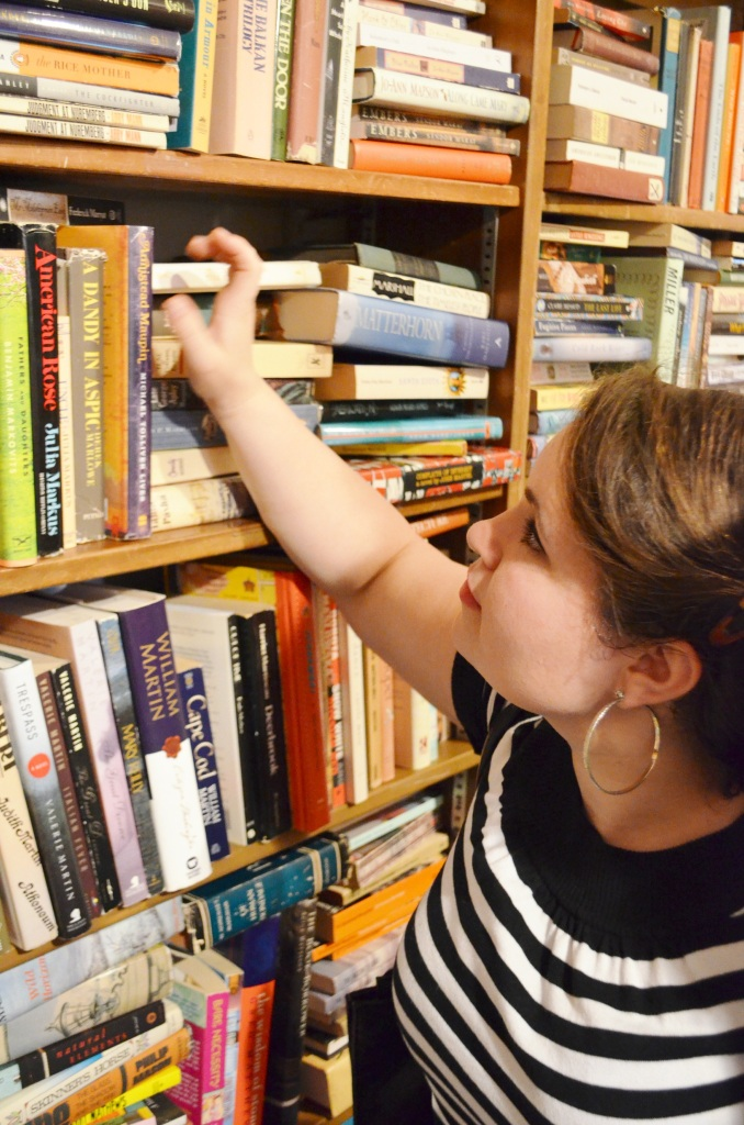 Me pretending to browse the book shelves. Capitol Hills Books sells used, rare and first-edition books, but it's pretty pricey for a used book store...most books were between $4 and $8.
