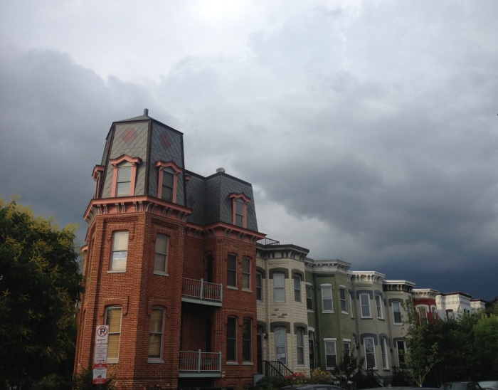 DC rowhouses and stormy  skies.