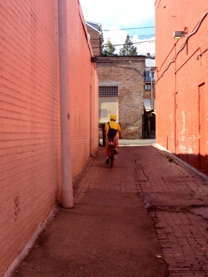 My dad biking down a Georgetown alley.
