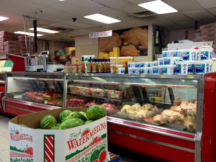 Poultry/beef section at the Culmore Supermarket. I especially enjoy the photo of raw chicken in the background.