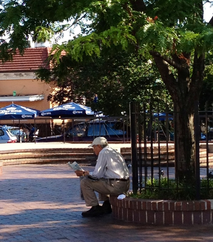 Reading the paper at Lamont Park.