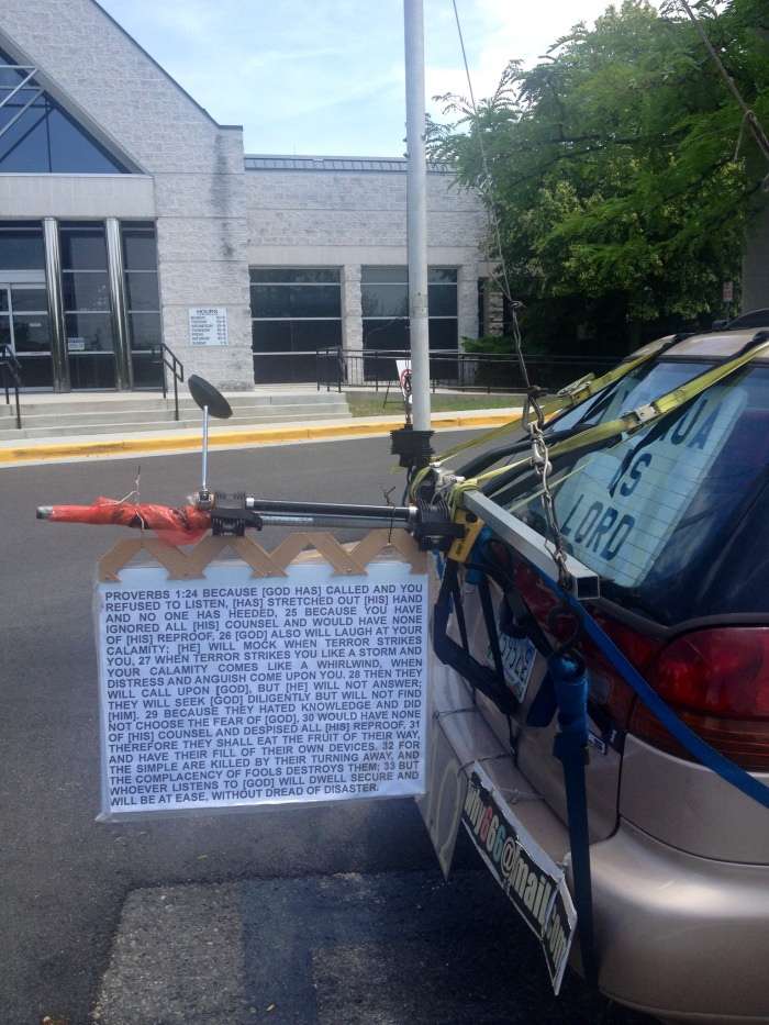 Biblical scriptures and a curious contraption on the rear of the car.