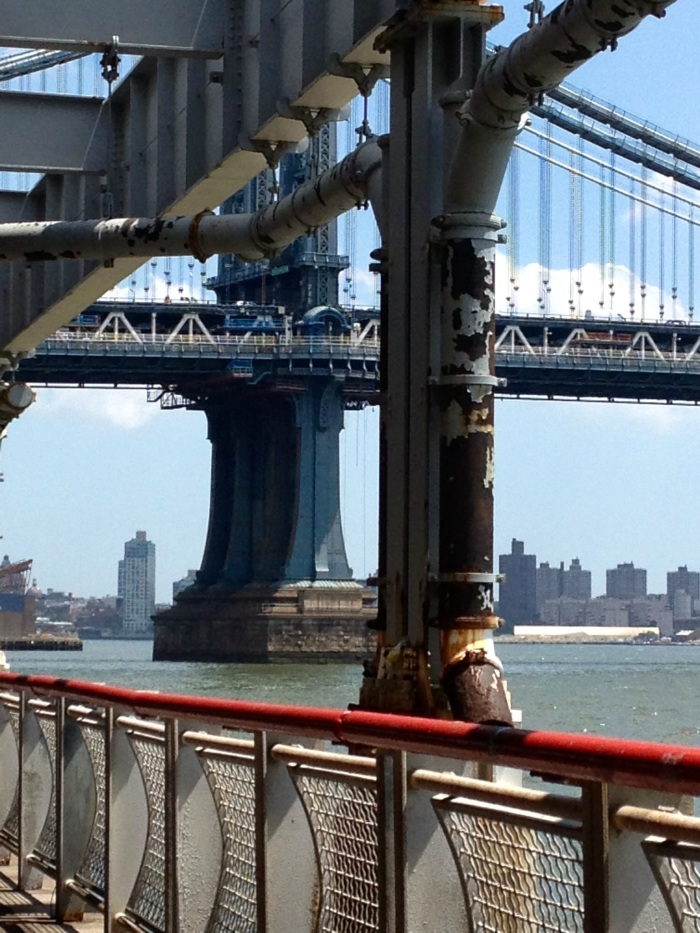 Industral angles, lines and metal. Another view of the Manhattan bridge, the Hudson River and the Brooklyn skyline.