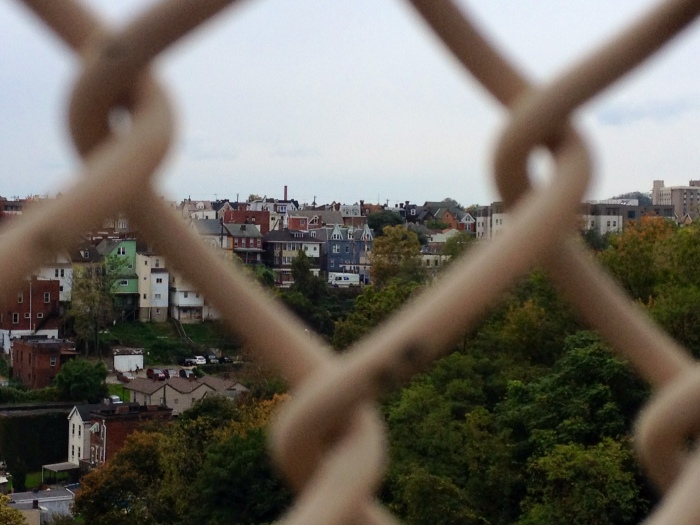 Pittsburgh Neighborhood behind a chainlink fence.