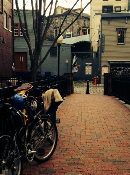 Bikes at the entrance of an alleyway.