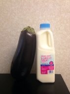 The most adorable milk carton I've ever seen. I've placed it next to a small eggplant so you can appreciate just how small it is.