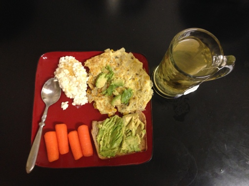 Healthy breakfast...cottage cheese with honey (my new best friend), egg white omelette with onion and corn with avocado, rye bread with avocado, baby carrots and green tea.