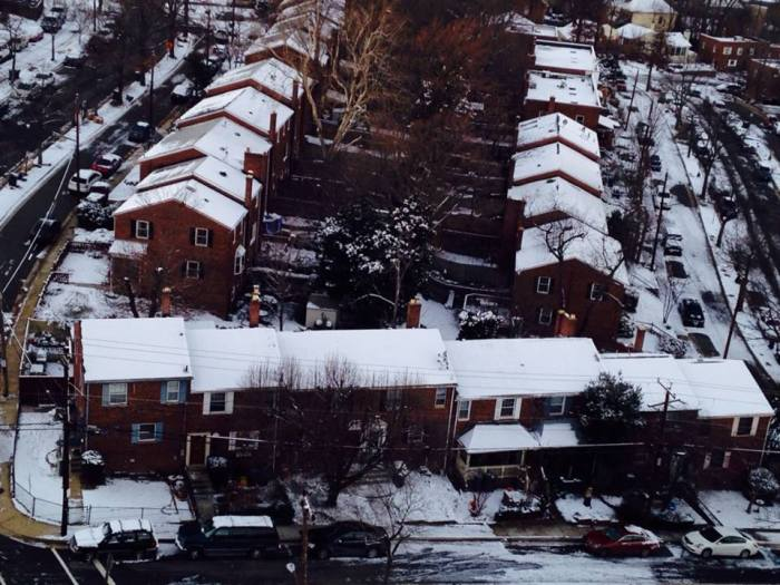 Snow-covered Del Ray townhouses.