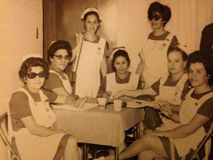 My grandmother as a Red Cross volunteer in Cali. Unlike many women of her generation, my grandmother worked as a nurse (an instrumentadora) from the time she was 16. My grandmother still remembers her time as a nurse fondly. I think it's funny how all the nurses in this photo are smoking. It was definitely a different time! This was probably taken sometime in the mid sixities when my gradmother was in her early thirties.