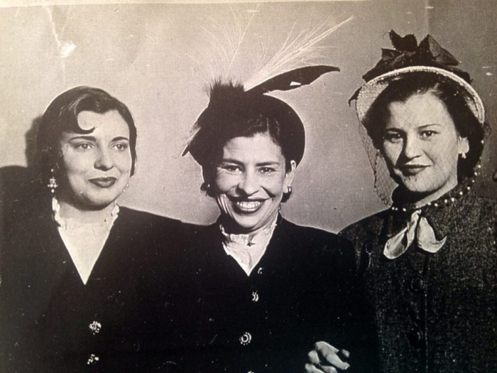 This is probably my favorite picture because it's just so retro, from the curled bangs to the feather hat to the button down coats. From left to right: My Great Aunt Sofia, my great grandma and my grandma. I believe she was pregnant with her first child in this picture.