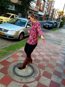 My sister pretending to fall in to a man hole. Yes, it's fake, but in theory, it would be easy enough to get your shoe stuck or twist your ankle if you aren't looking down!