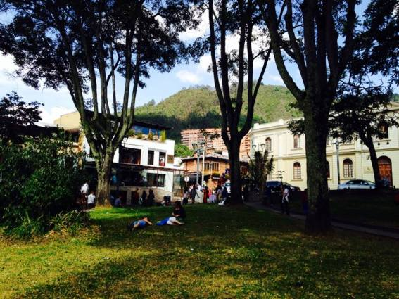 People hanging out at El Parque de Usaquen. Here you can see some of the old timey architecture in the background.