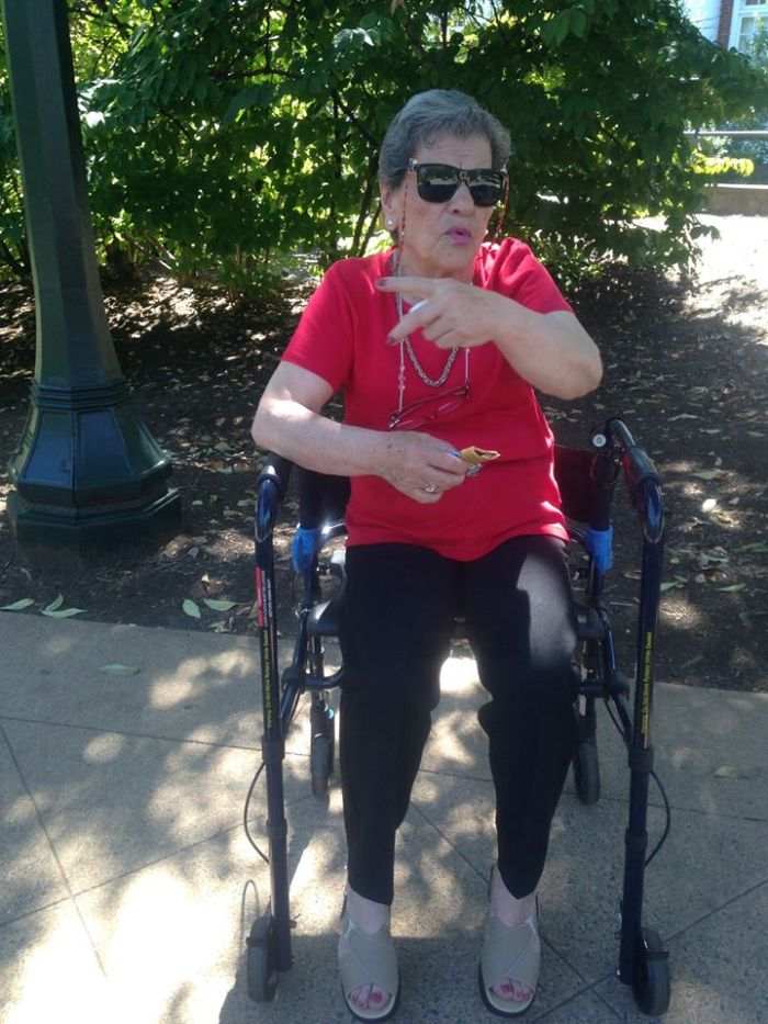 Here she is, making some sort of hand gesture while relaxing on her walker in Charlottesville, VA.